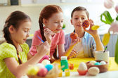Preschoolers decorating Easter eggs — Stock Photo