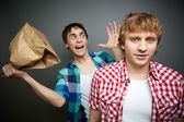 Guy being ready to explode paper bag — Stock Photo