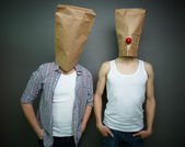 Guys in paper bags — Stock Photo
