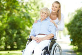 Nurse walking out with patient — Stock Photo