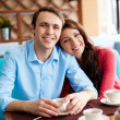 Couple having coffee in cafe — Stock Photo