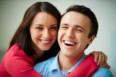 Woman embracing her happy husband — Stock Photo