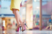 Lady legs in high-heeled shoes — Stock Photo