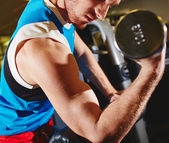 Man doing exercise with barbell — Stock Photo