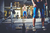 Man  in gym with weight — Stock Photo