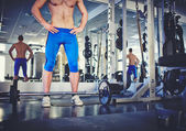 Man standing in gym with weight — Stock Photo