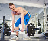 Sportsman lifting heavy weight in gym — Stock Photo