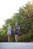 Couple running outdoors — Stock Photo