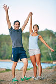 Couple raising arms — Stock Photo