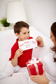Lad with congratulating to his mother — Stock Photo