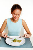 Girl ready to eat peas and leeks — Stock Photo