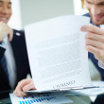 Entrepreneurs reading contract — Stock Photo