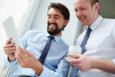 Businessmen using touchpad — Stock Photo