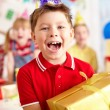 Boy with big red giftbox — Stock Photo