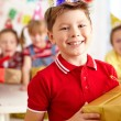 Boy with gift box — Stock Photo