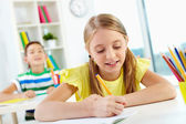 Girl drawing at lesson — Stock Photo