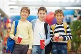 Schoolboys with soda — Stock Photo