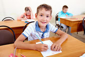 Boy with classmates — Stock Photo