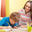 Schoolwork with mother — Stock Photo #47815749