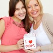 Mother and daughter with giftbox — Stock Photo #47817279