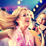 Girl singing at party — Stock Photo