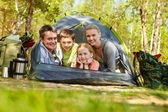 Family of travelers in tent — Stock Photo