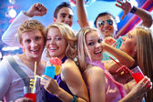 Girls with cocktails at party — Stock Photo