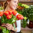 Florist with red tulips — Stock Photo #47822915