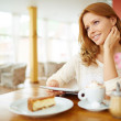 Woman with touchpad in cafe — Stock Photo #47823003