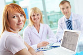 Patient and two practitioners — Stock Photo