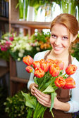Florist with red tulips — Stock Photo