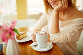 Woman with cup of latte — Foto Stock