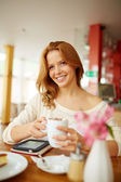 Woman having cup of coffee — Stock Photo