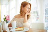 Girl sitting in cafe — Stock Photo