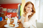 Woman enjoying dessert in cafe — Stock Photo