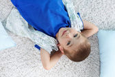 Kid lying on the floor — Stock Photo