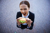 Businesswoman with sandwich — Stock Photo