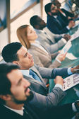 Business people at seminar — Stock Photo