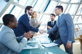 Business people congratulating colleagues — Stock Photo