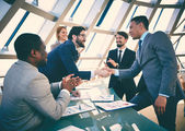 Business people striking grand deal — Stock Photo