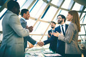Successful businessmen handshaking — Stock Photo