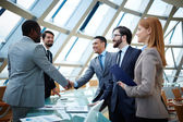 Businessmen handshaking — Stock Photo