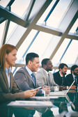 Business people listening to presentation — Foto Stock