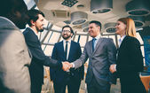 Business people handshaking — Stock Photo