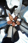 Friendly businesspeople in suits — Stock Photo