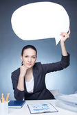 Businesswoman holding blank speech bubble — Stock Photo