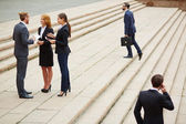 Business people interacting outside — Stock Photo