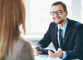 Businessman interviewing female — Stock Photo