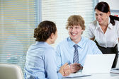 Friendly workteam discussing project — Stock Photo
