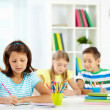 Girl drawing with schoolmates — Stock Photo #49214537